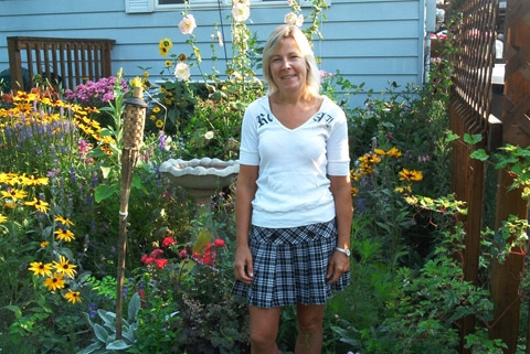 Patti Sage, Sage Gardens, Garden maintenance, hedge trimming, planning gardens, planting annuals, planting perennials, garden enlargements, installation of new gardens, seasonable pruning, spring fall cleanup, Wellington County, Ontario, in her garden